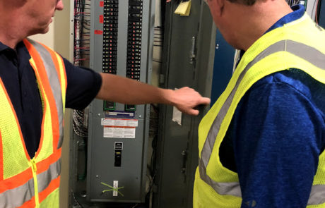 Two Workers by a Circuit Board